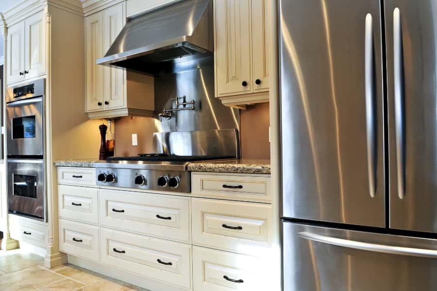 hide chimney pipe behind kitchen cabinet
