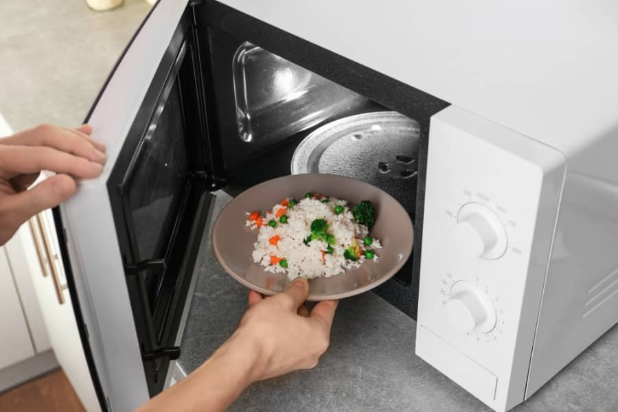 fix undercooked rice on microwave oven