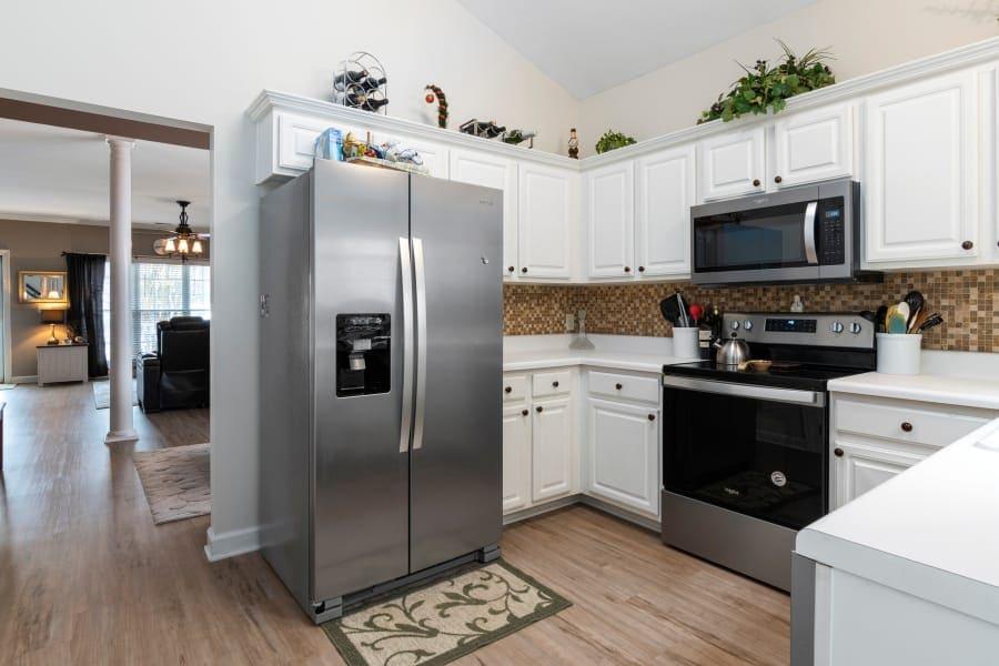 side by side refrigerator in kitchen