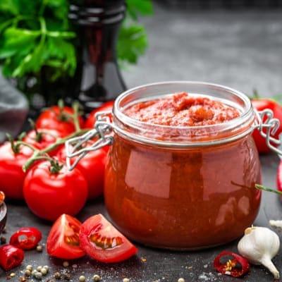 Preparing Homemade Tomato Sauce with hand blender
