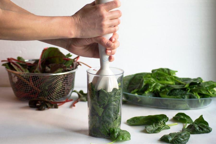 blending vegetables with hand blender